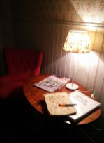 A restful corner in Sussi's cafe with armchair and reading