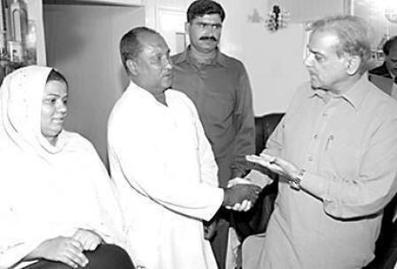 Shahbaz Sharif with ashiana housing family