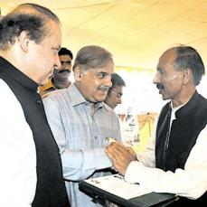 Shahbaz Sharif distributing allotmant letters of Ashiana Houses