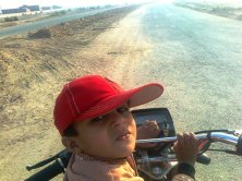 Muhammad Usman Riding Bike on FJ Town Phase 2 100 feet Road