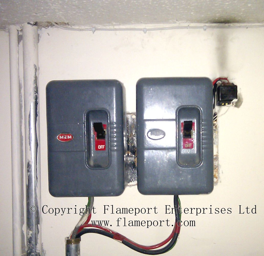 Electrician Testing Doorbell Transformer With Multimeter