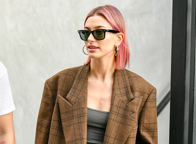 Model Hailey Baldwin wearing an oversized brown and black striped blazer, debuts her pink hair