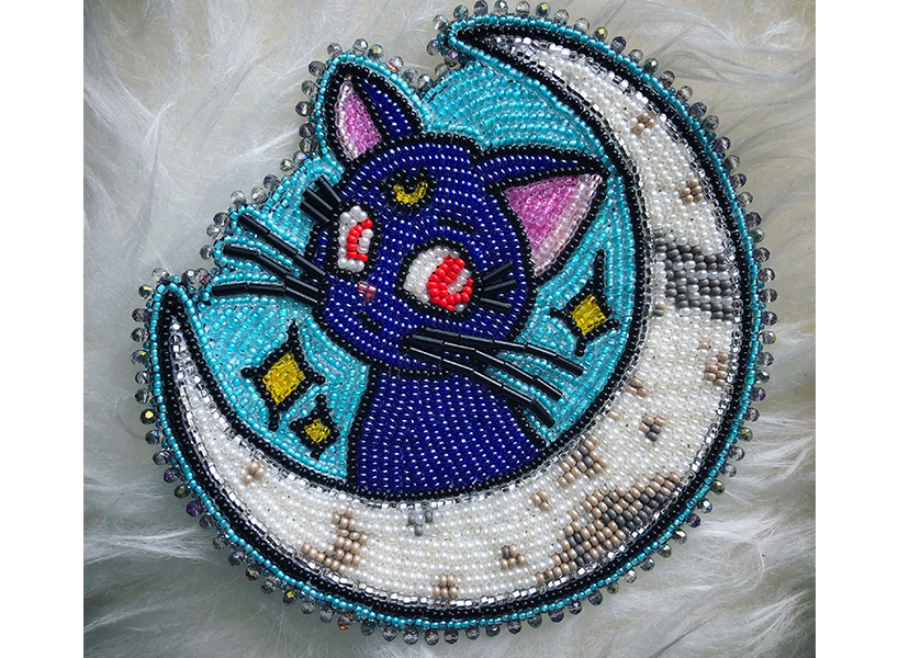 A A beaded cat patch by accessories designer Blue Hummingbird