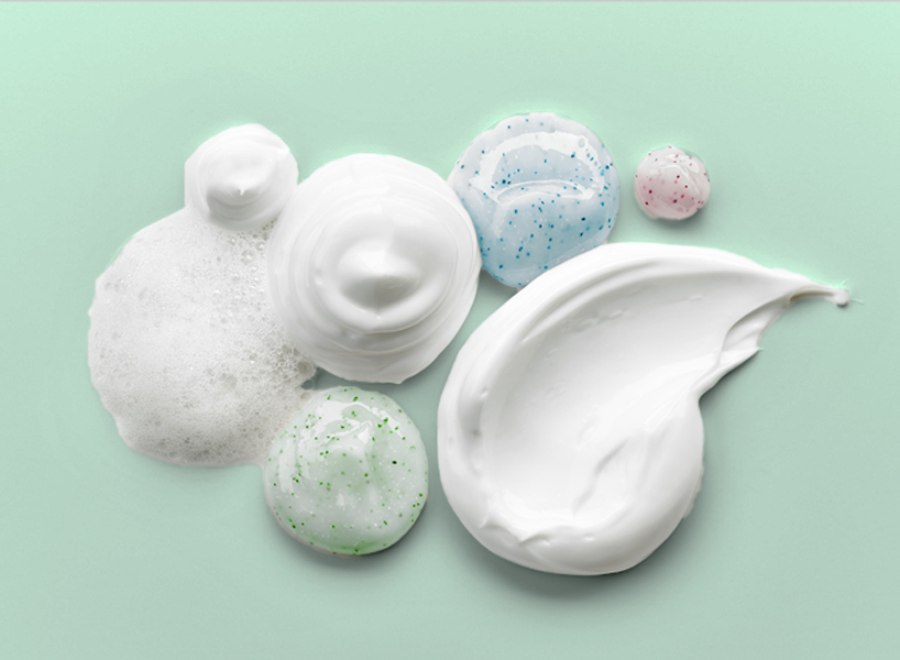 Blobs of the best skincare ingredients on a green background