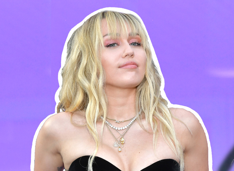celebrity hairstyles 2020: Miley poses on the red carpet in a strapless black gown with her blonde hair down in waves