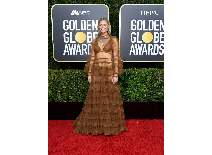 Gwyneth Paltrow wears a brown sheer dress on the Golden Globes 2020 red carpet