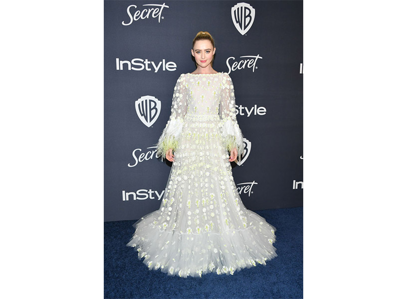 Kathryn Newton wears a white feathered gown on the Golden Globes 2020 red carpet