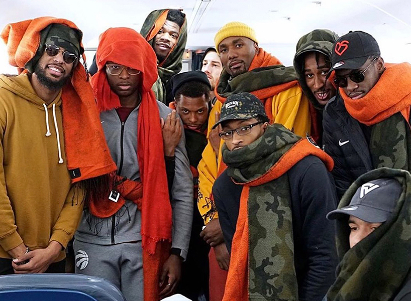 serge ibaka the raptors scarves: The Raptors are pictured on a plane wearing their orange and camo scarves