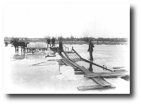 To business. Lake Michigan is frozen stiff. Fancy, O child of a torrid clime, a sheet of anybody's ice, three hundred miles long, forty broad, and six feet thick! Artwork : This photo of men cutting ice on Ashbridge's Bay comes to us via the . It is in the public domain.
