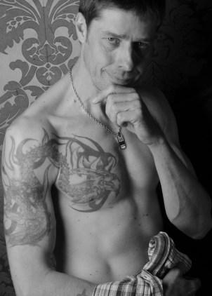 tattooed shirtless man