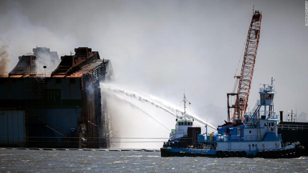 Seawater being used to put out fire on a cargo ship wreckage off the Georgia coast