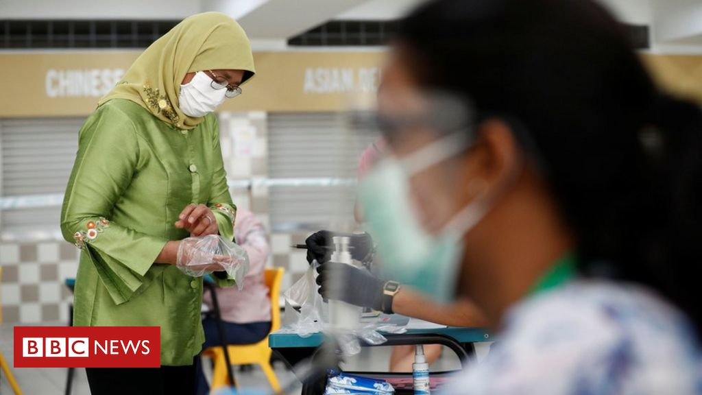 Singapore votes against backdrop of pandemic