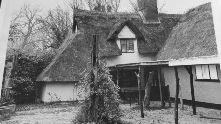 Black and white photo taken around 1929 of Bridge Cottage and the building that later became the National Trust Shop
