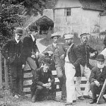Black and white photo of Ipswich & District Photographers Society posing outside Willy Lott's House 1890s