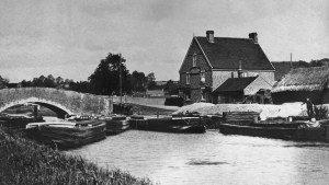 Black and white photo of barges at rest in Nayland