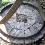 Photograph of millstone from Flatford Mill with iron hoops overarching