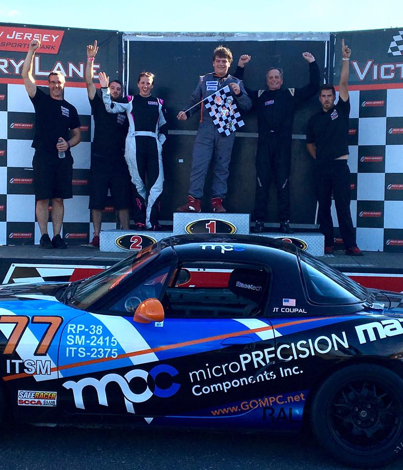 Sometimes a picture is all you need! On a hot August weekend at New Jersey Motorsports Park, Flatout drivers JT Coupal (first), Amy Mills (second), and Whit Gregg (third) took over the podium after the Spec Miata race. Our clients are way fast! (The cars we build ain't bad either.)