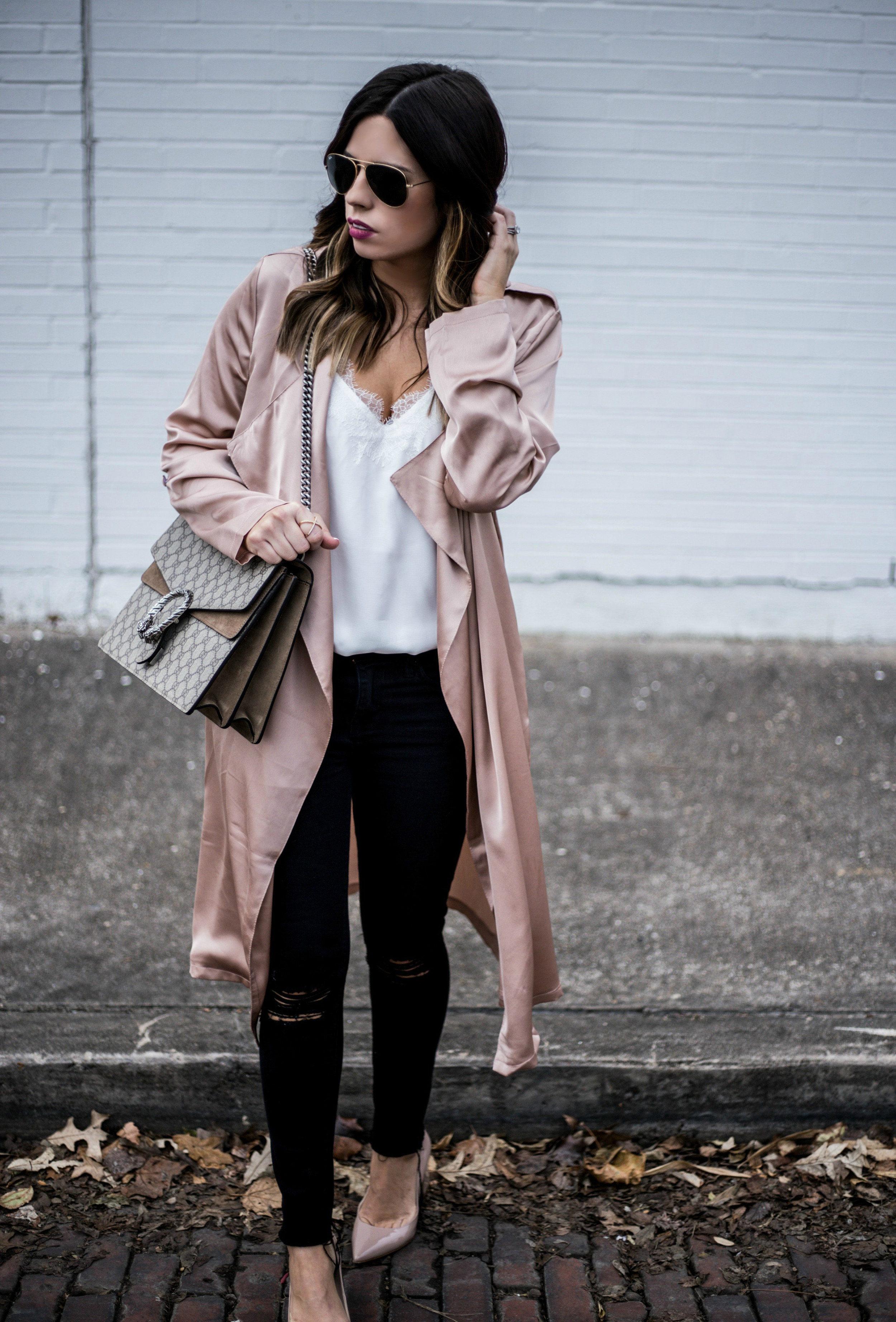 Satin blush duster paired with black distressed skinny jeans   what's currently trending in women's fashion 2016