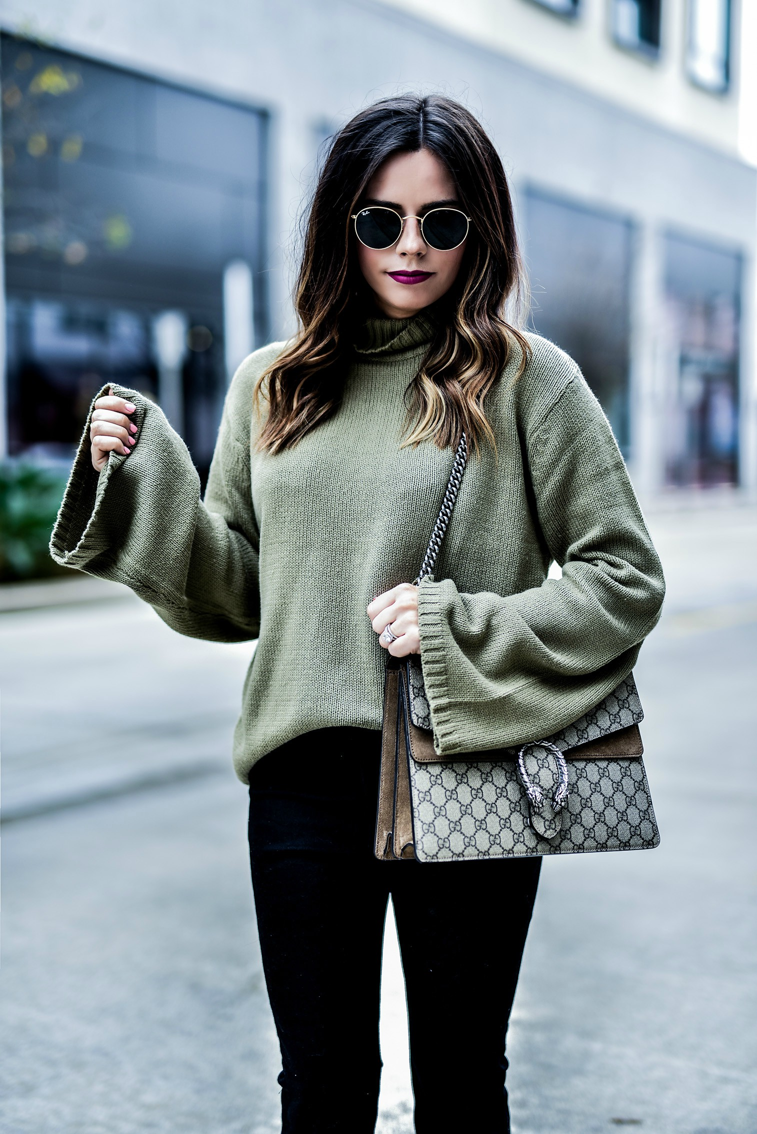 Tiffany Jais Houston fashion and lifestyle blogger Wearing a bell sleeve sweater in olive, and black denim flare cropped jeans, click to read the post | Gucci Dionysus bag, what's trending