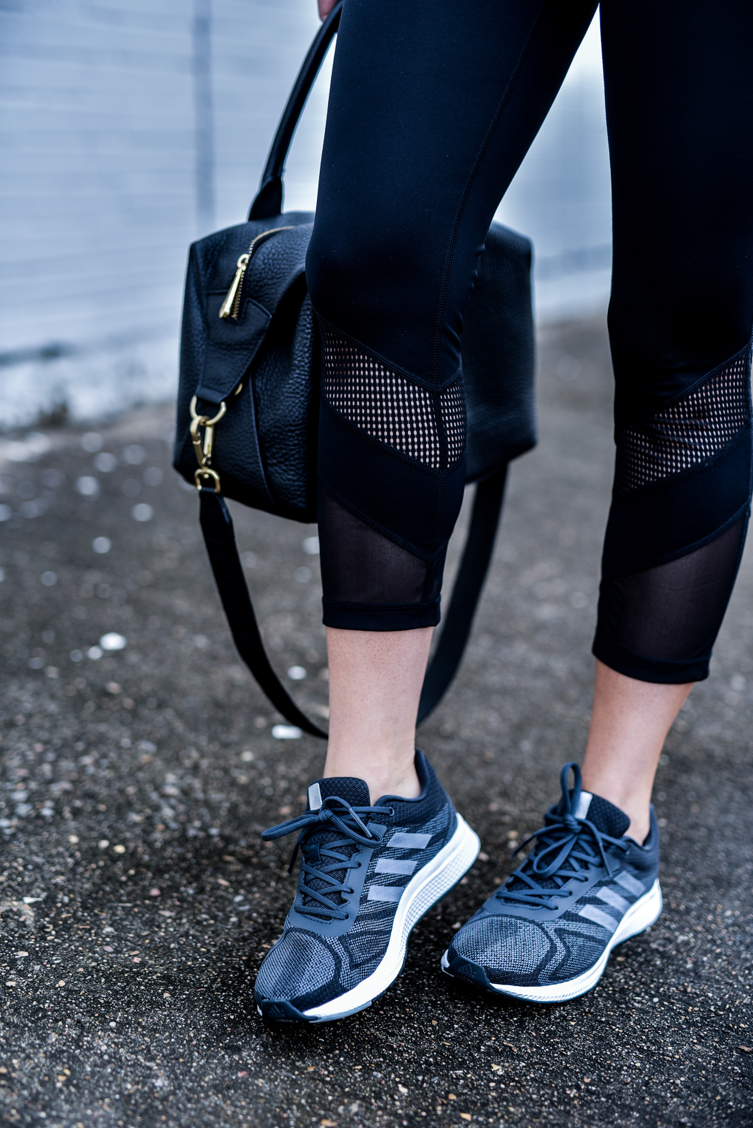 Houston fashion and style blogger tiffany Jais wearing cutout mesh leggings and grey addidas sneakers, click to read more | What's trending in women's fitness wear