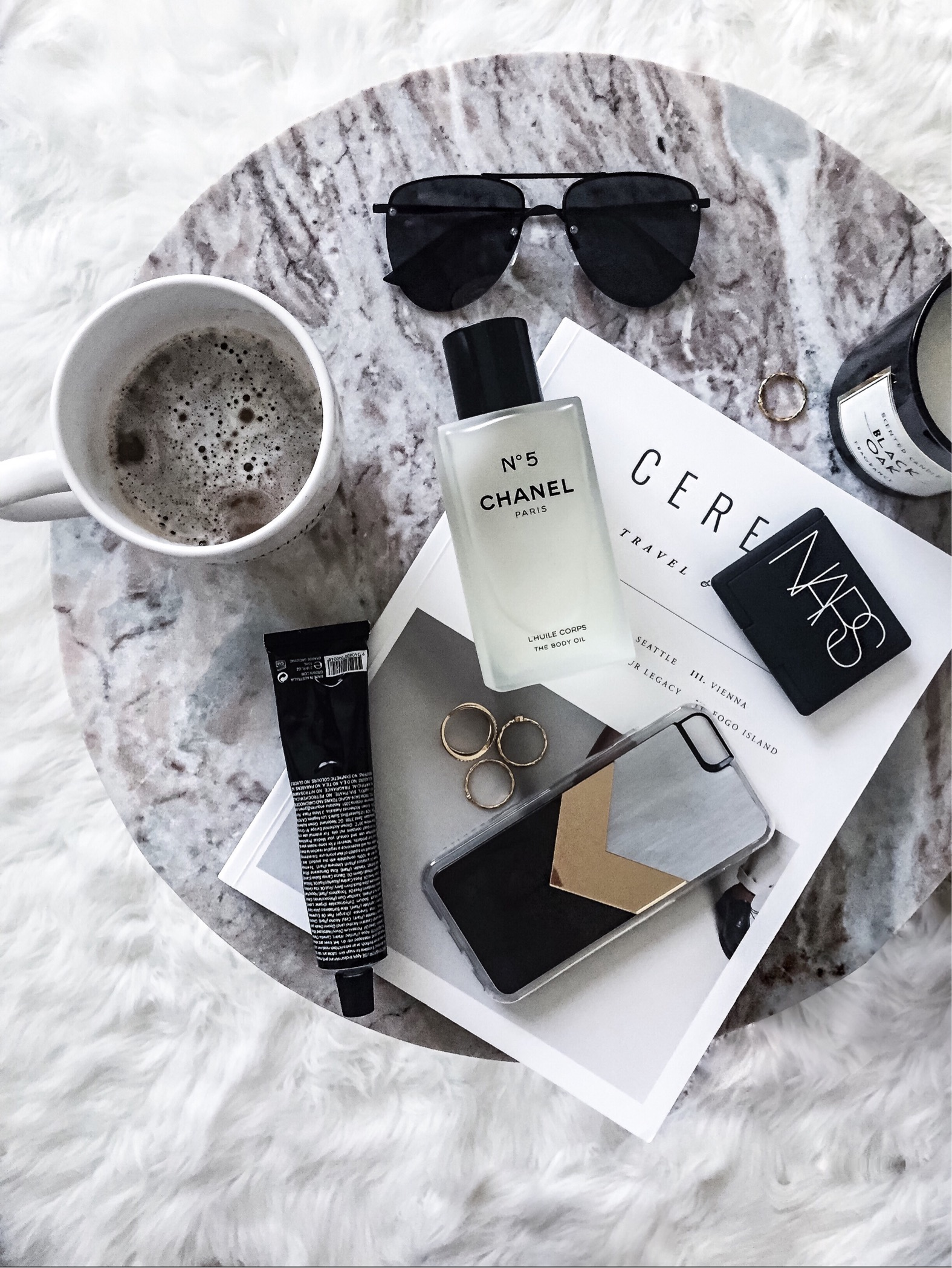 Click here to read about Houston fashion blogger Tiffany Jais | Cereal magazine, Le Spec Sunglasses | Coffee, Grown Alchemist hand cream, zero gravity iPhone case