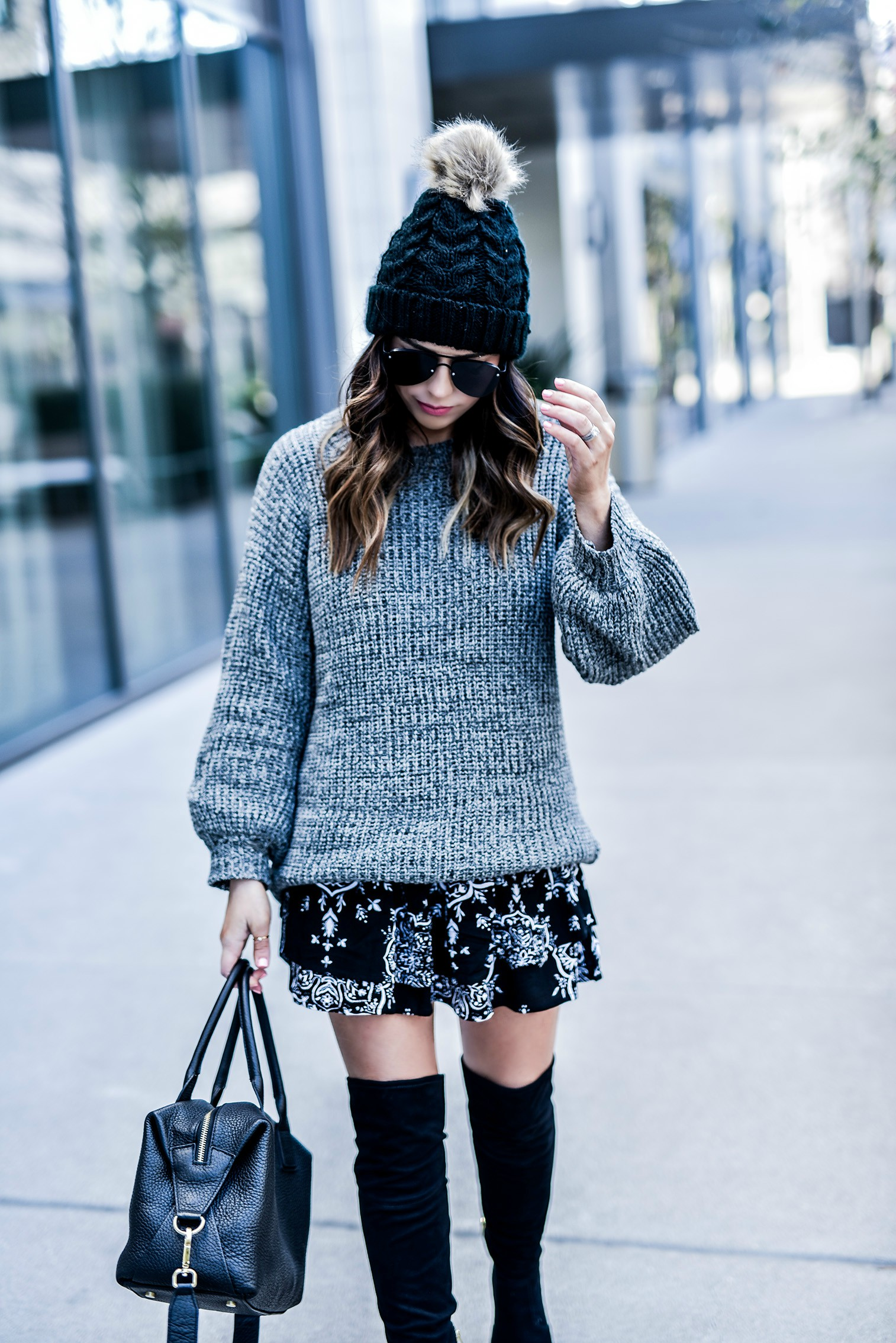 Tiffany Jais Houston fashion and lifestyle blogger of Flaunt and Center wearing a Revolve chunky knit sweater and a Revolve skirt | Streetstyle outfit ideas