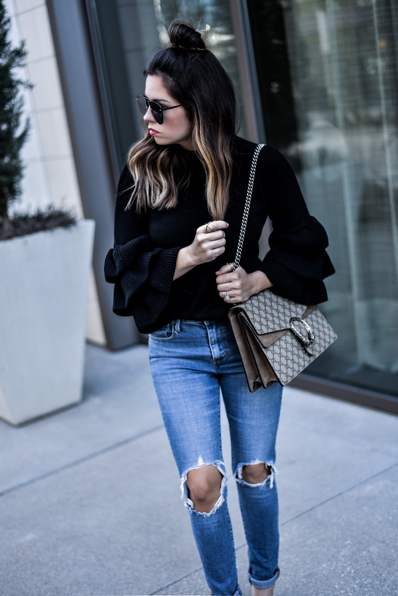 Tiffany Jais Houston fashion and lifestyle blogger wearing a ruffle embellished sleeve top and levis jeans | What's trending in fashion