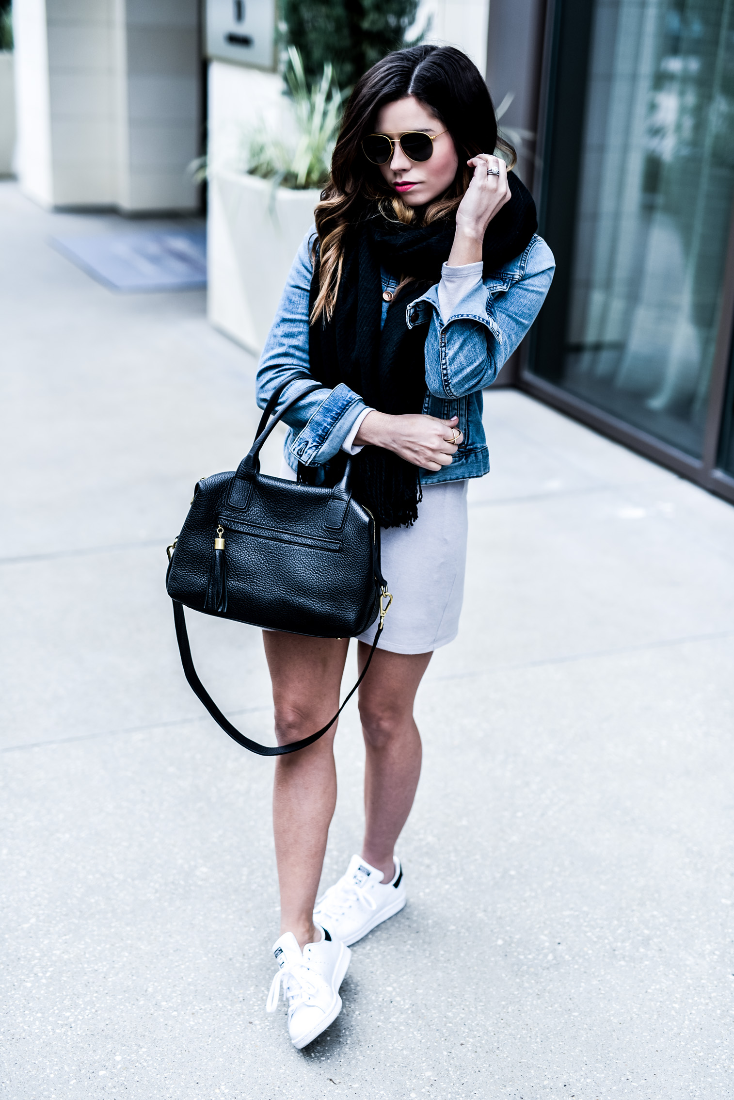 Adding layers | Tiffany Jais Houston fashion and lifestyle blogger of Flaunt and Center wearing a grey Revolve dress and a denim jacket by Madewell