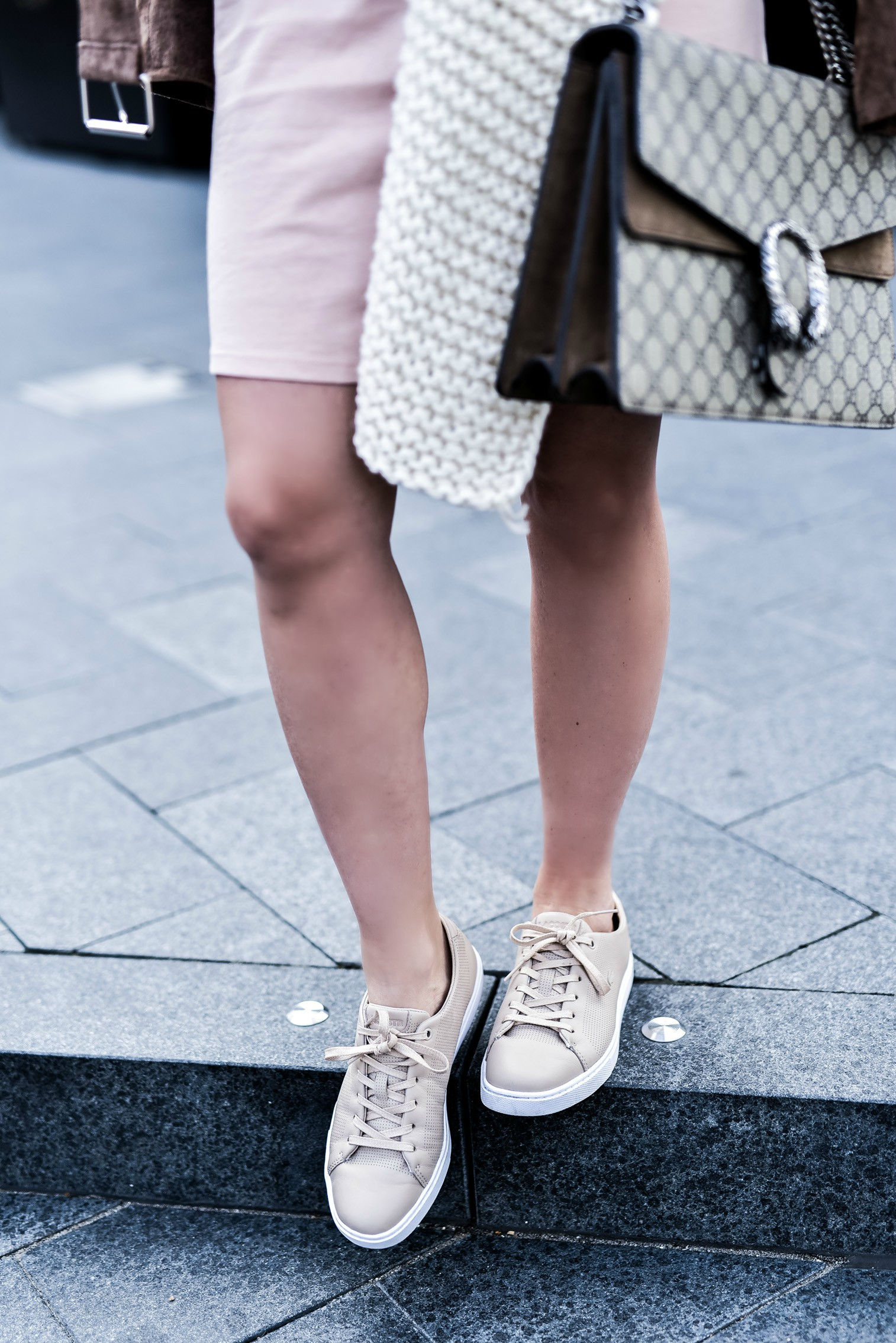 Houston fashion blogger wearing an asos pink dress and a blank nyc suede moto jacket, read up on how to concur effortless casual style by clicking this photo | Gucci Dionysus bag, chunky knit scarf, Lacoste sneakers and a dress