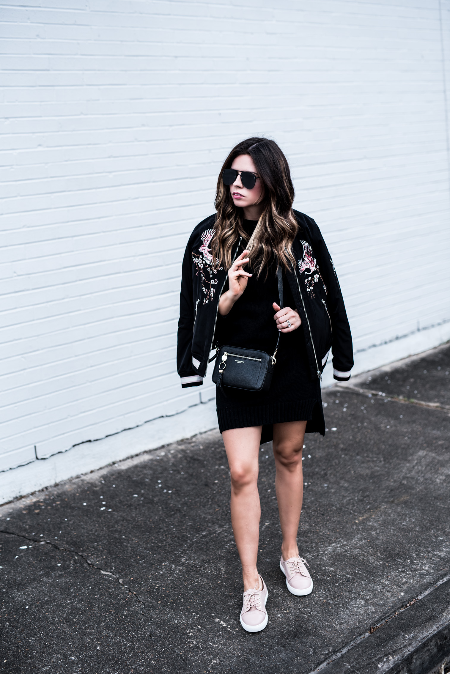 Houston fashion blogger wearing a col shoulder sweater dress by Revolve, and a neutral sneaker by Elaine Turner, click to shop the look | Outfit ideas for spring, bomber jacket, blogger style, fashionista, best casual outfits
