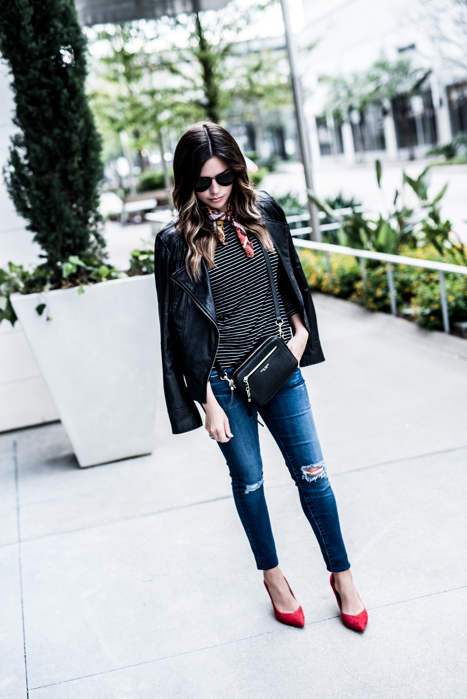 Houston fashion and lifestyle blogger wearing a stripped tee and red heels from Banana Republic | Outfit ideas, necktie scarf outfits, leather jacket outfits,