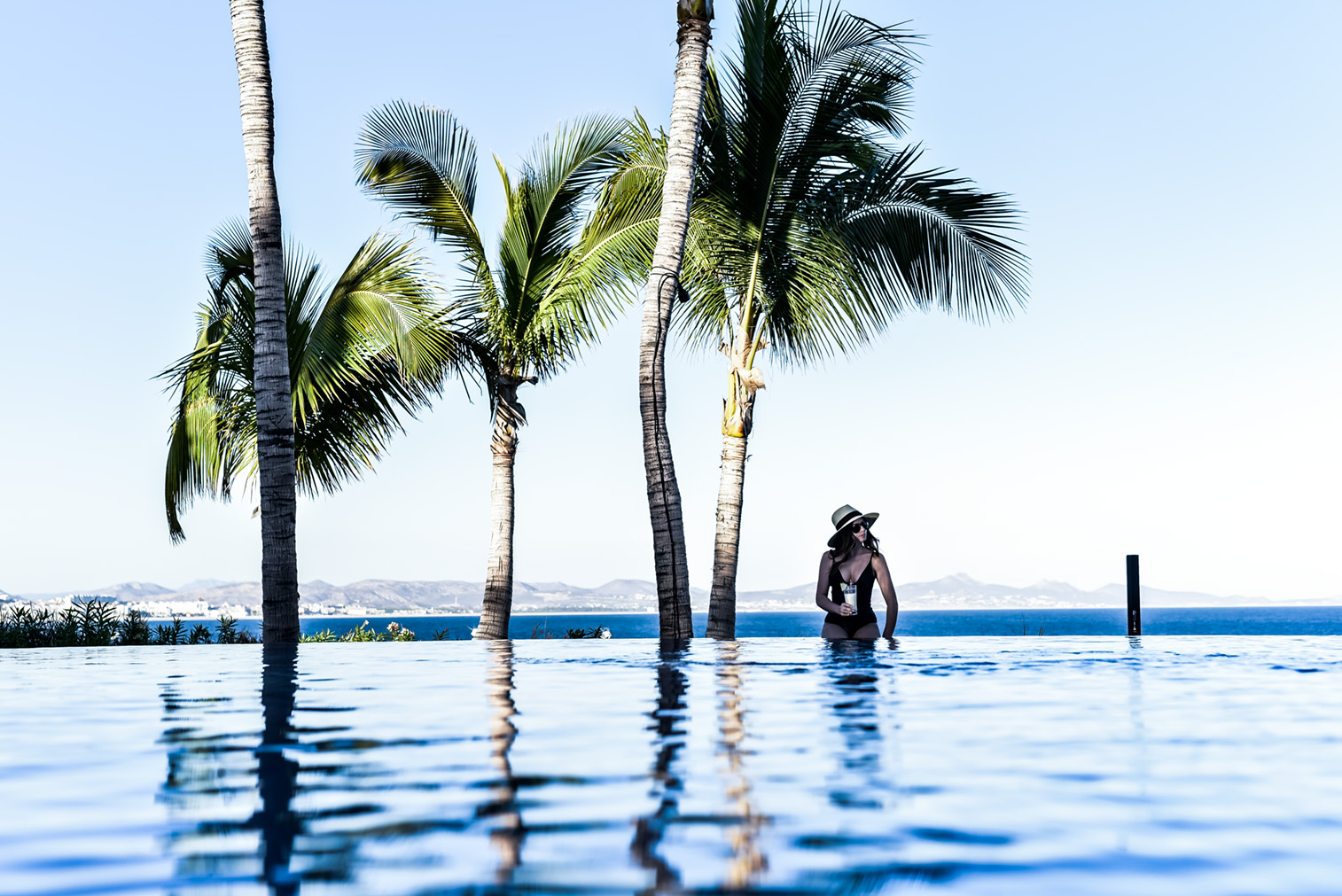Loved staying at the One & Only Palmilla in Cabo San Lucas! The food, the view infinity pool, and the clear waters had me never wanting to come home! Click to read up on my stay here   Vacation spots in Cabo San Lucas, travel destinations, travel blogger, Cabo, Brixton Willow hat
