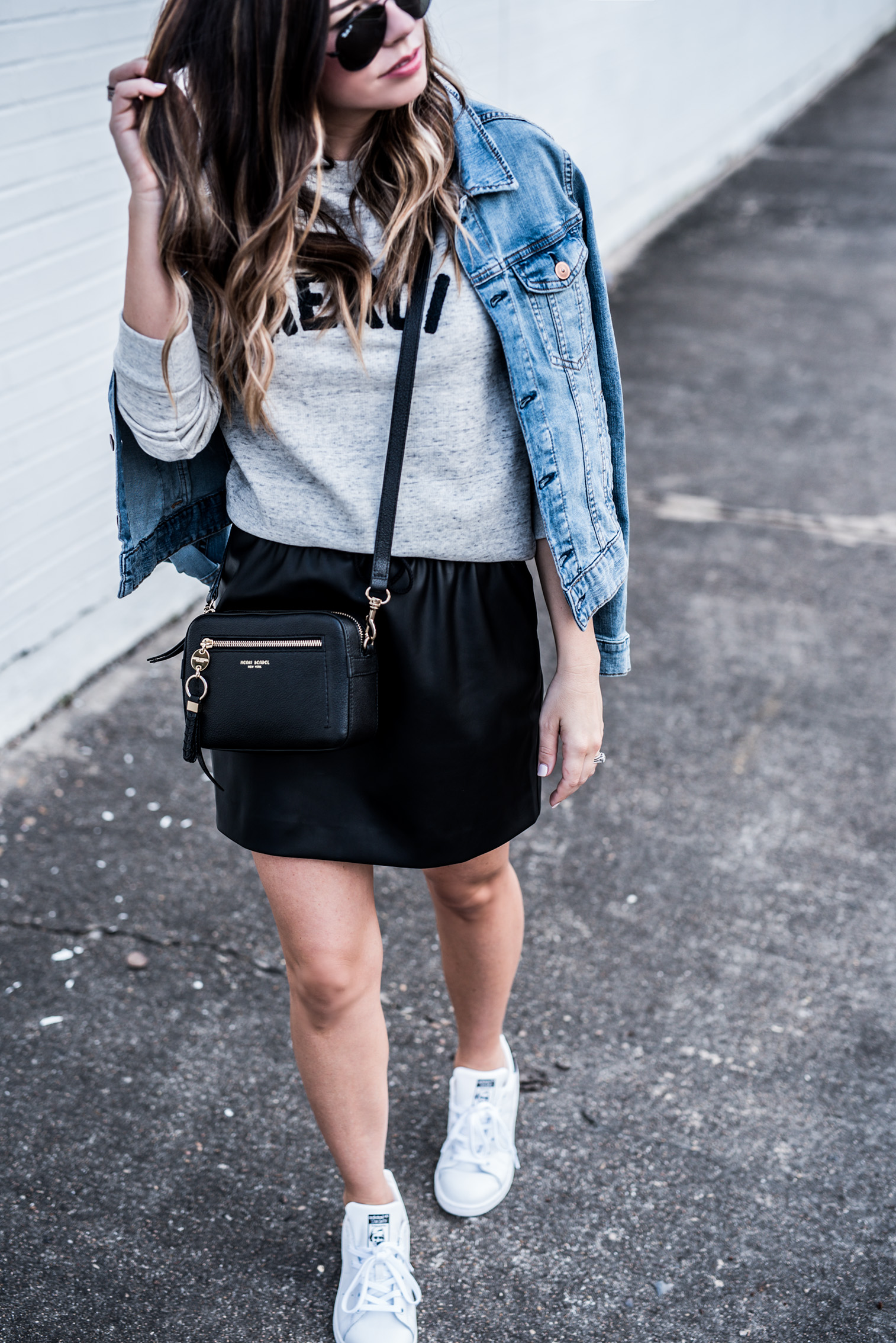 Houston fashion and lifestyle blogger Tiffany Jais wearing a leather skirt and stan smith sneakers | Outfit ideas for spring 2017, casual streetstyle,