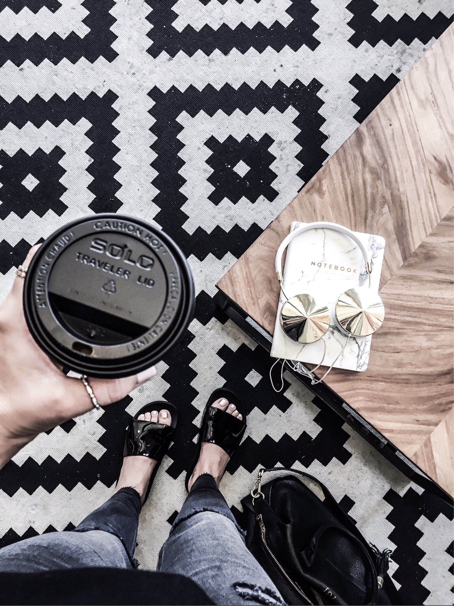 Houston fashion and lifestyle blogger Tiffany Jais | Black slides, flatlay, fashion flatlays, frends headphones | coffee shop vibes
