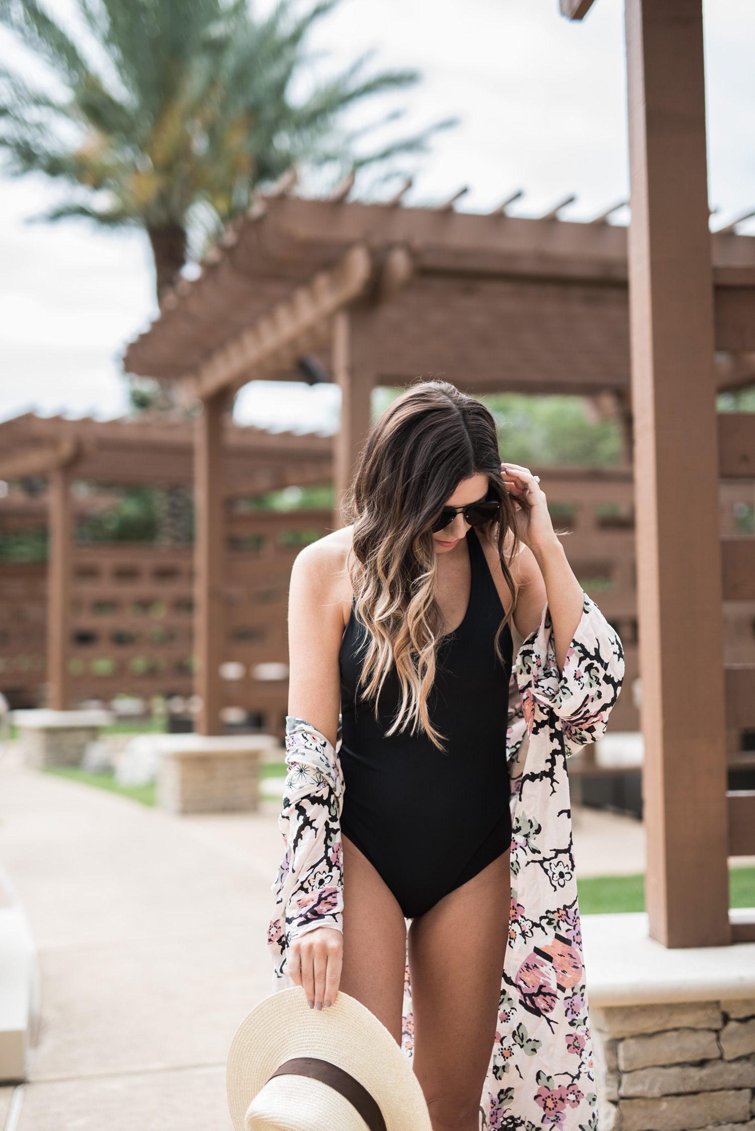 Tiffany Jais Houston fashion and lifestyle blogger | Black one piece suit, floral cover up, pool outfit ides, free people,