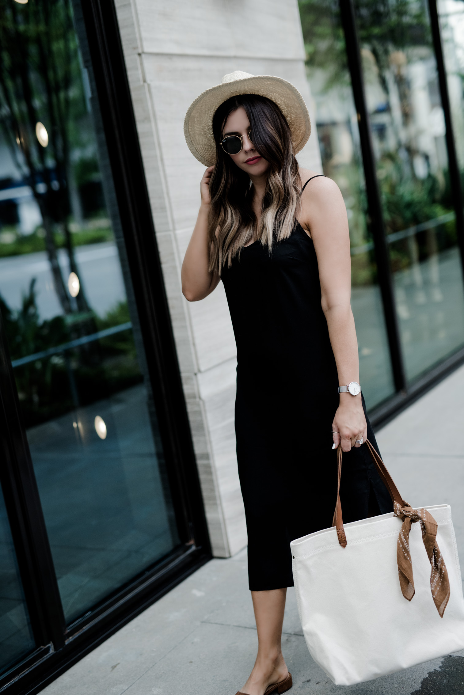 Tiffany Jais Houston fashion and lifestyle blogger | Slip dress obsessed | Slip dress street style | Madewell canvas tote, fedora hat outfit, brown slides, slides shoes. Click to shop the look