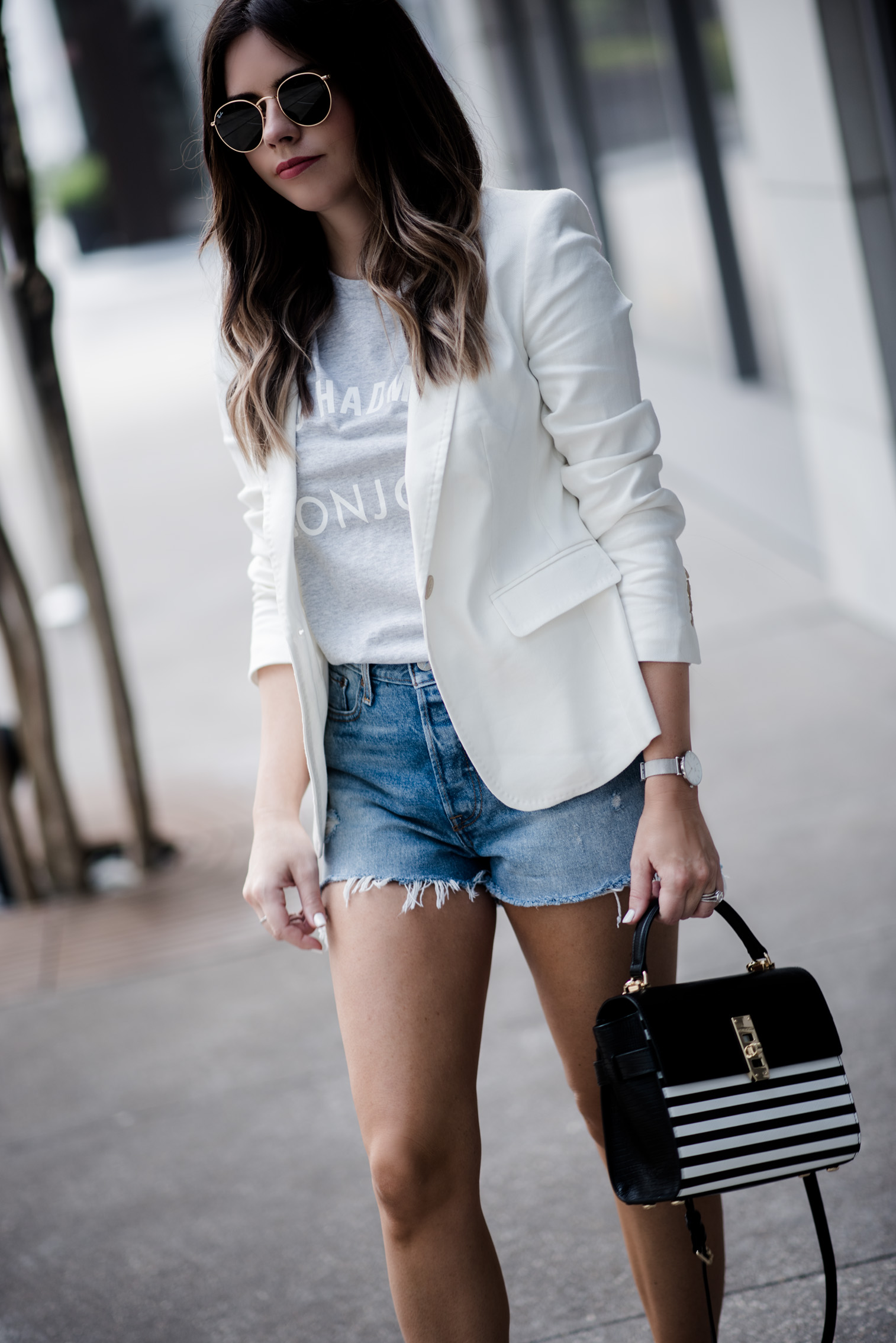 Tiffany Jais Houston fashion and lifestyle blogger | graphic tee outfits, how to wear a blazer with shorts, street style summer, casual outfit ideas, blazer outfits,