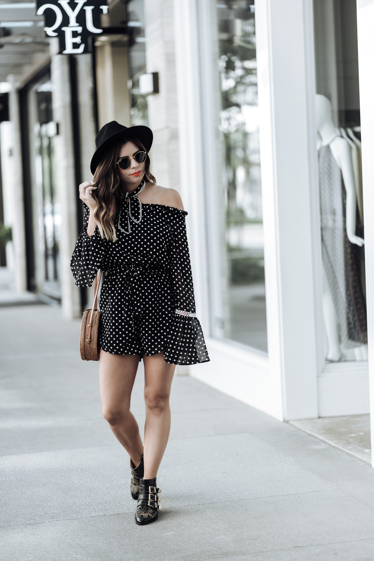 Tiffany Jais Houston fashion and lifestyle blogger | polka dot romper | round rattan bag, chloe studded boots, brixton hat , street style looks
