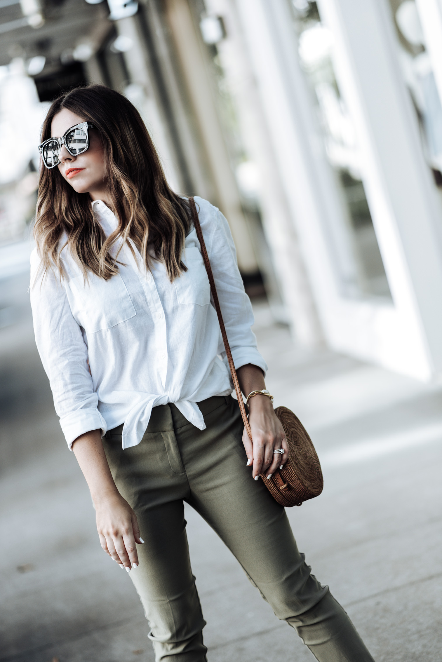 Tiffany Jais Houston fashion and lifestyle blogger | Versatile closet pieces |Worthington Lux ankle pant | White button down shirt | Round rattan bag | The bridge Sandal by Everlane | C/O Kendra Scott bracelets here & here | C/O Monica Vinader Bangle