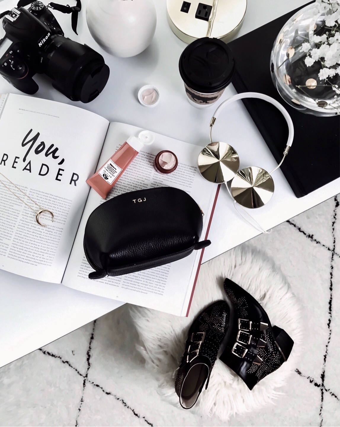 Tiffany Jais Houston fashion and lifestyle blogger | flatlay photo, chloe studded boots