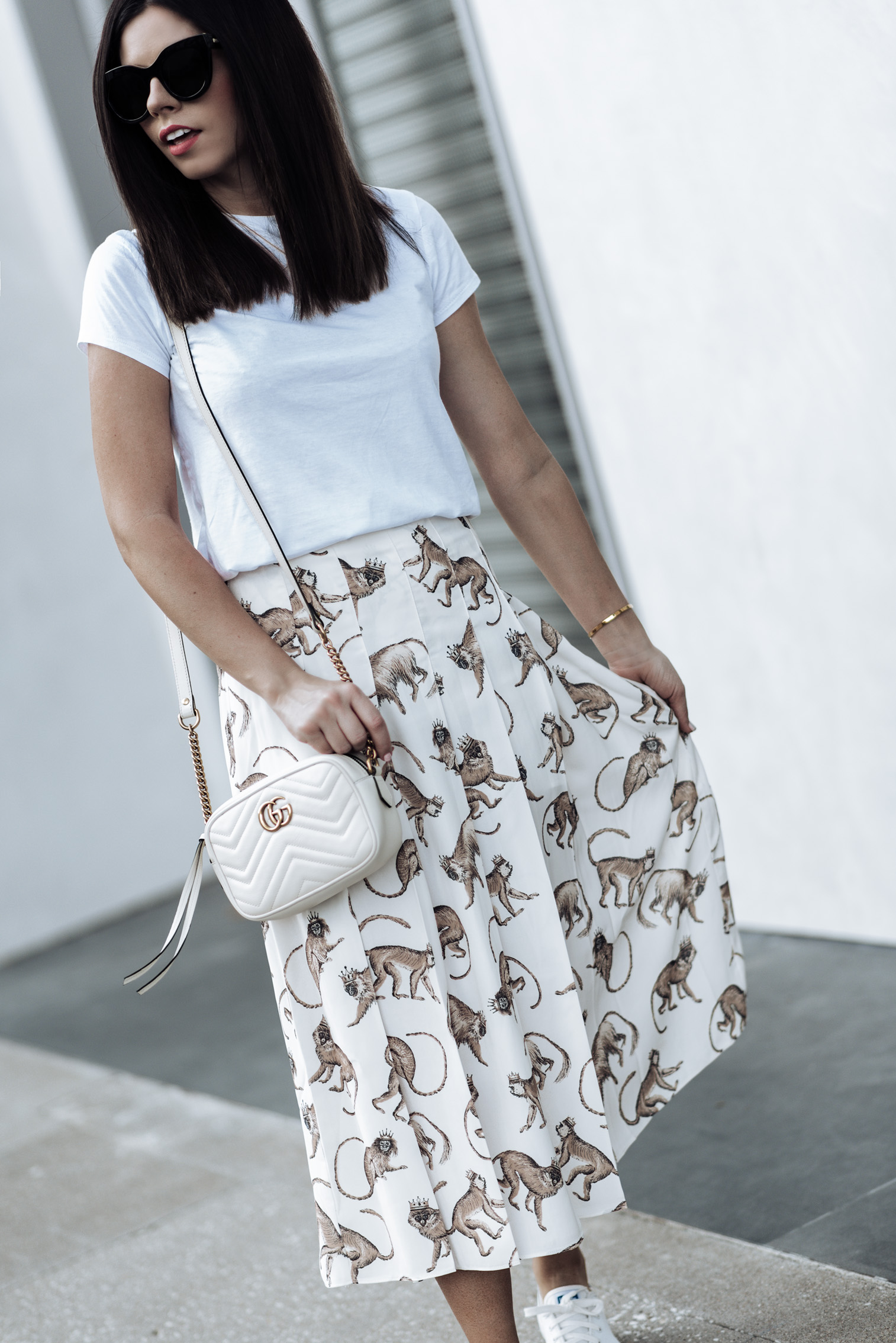 Tiffany Jais fashion and lifestyle blogger of Flaunt and Center | Monkey Print | Houston fashion blogger | Printed monkey skirt H&M | White Cotton Tee | Keds Kickstart leather sneaker | Gucci Marmont in white