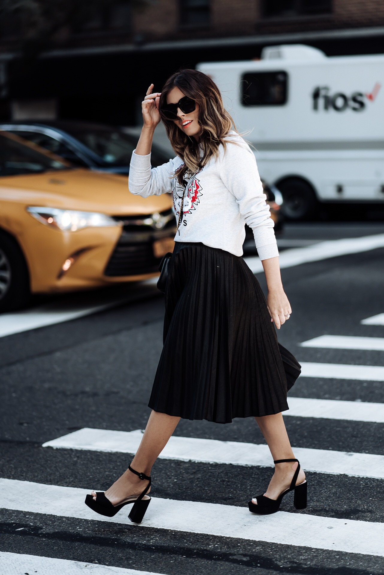 Tiffany Jais fashion and lifestyle blogger of Flaunt and Center | NYFW | NOMO SOHO NYC | Black pleated skirt | Kenzo sweatshirt women | NYC NYFW