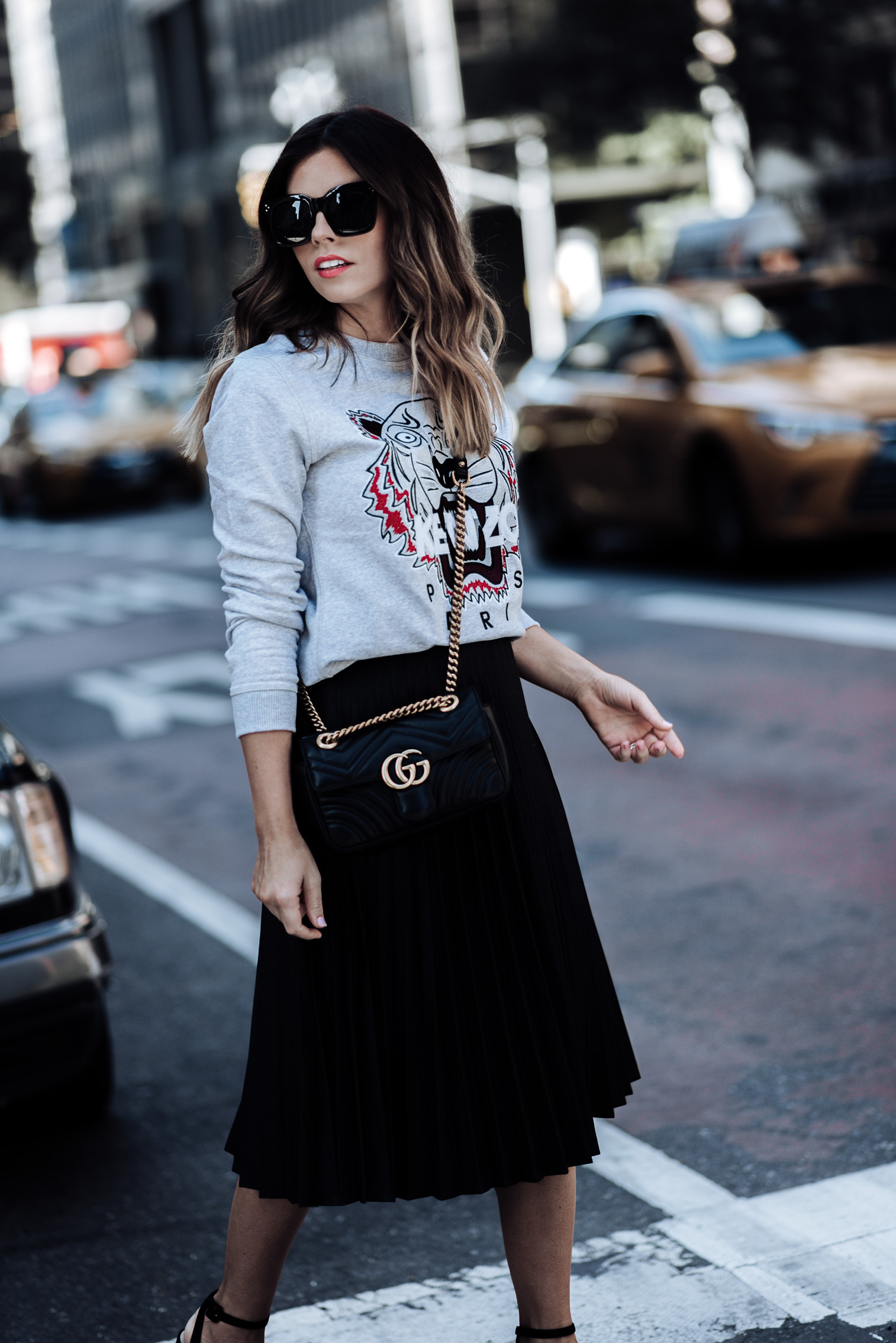 Tiffany Jais fashion and lifestyle blogger of Flaunt and Center | Houston fashion blogger | NYFW day 2 outfit | Streetstyle blog Pleated skirt | Kenzo Sweatshirt | Platform heels | Gucci Marmont Bag