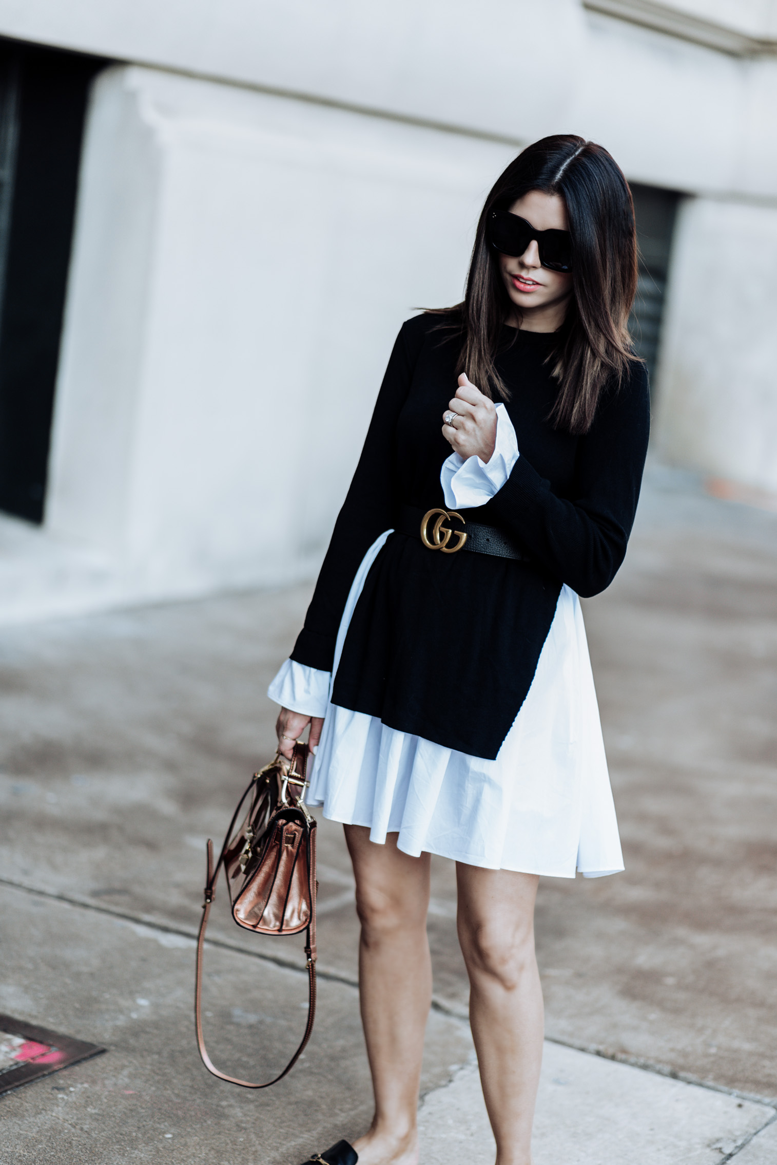 Click to shop the look. Houston fashion and style blogger | Black and white styles | English Factory Knit Combo Dress (Similar style here) | Rebecca Minkoff Mini Paris Crossbody | Similar Black Mule Slides | Gucci Double G belt (men's pebbled leather) |