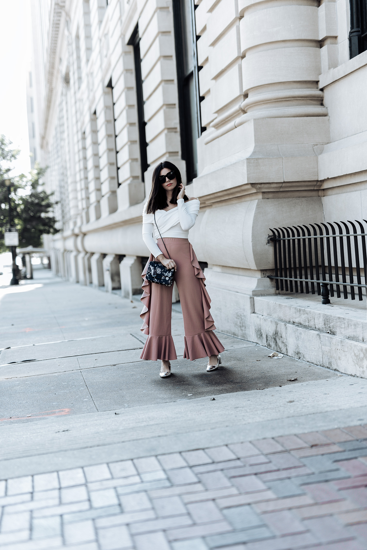 Ruffle Pant Trend, click to shop the look   Streetstyle blog, blog, Edie Ruffle Side Pant   {C/O} Waldorf Floral Print Party Bag   Off the Shoulder Crop Top   Silver pumps (Via Zara, Similar here)