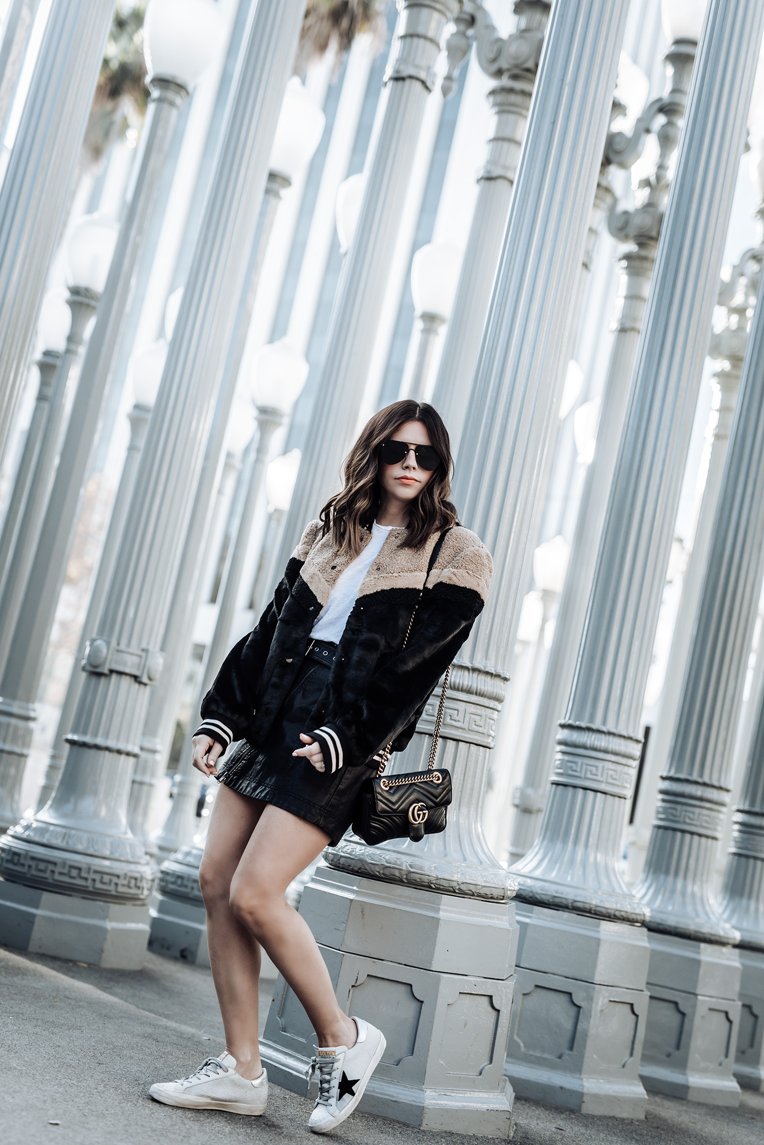 Faux fur bomber (Lord & Taylor) | Free People Feeing Fresh vegan leather skirt | Golden Goose Superstar Sneakers | Gucci Bag | Faux fur bomber | skirt |