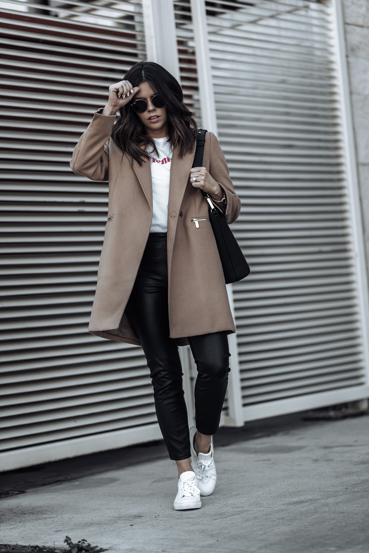 Camel coat via Topshop (similar here) | {C/O} Greats Sneakers (similar) | The principle mid rise vegan leather pant via Shopbop | Sezane La Femme Tee | Topshop bucket bag (similar)