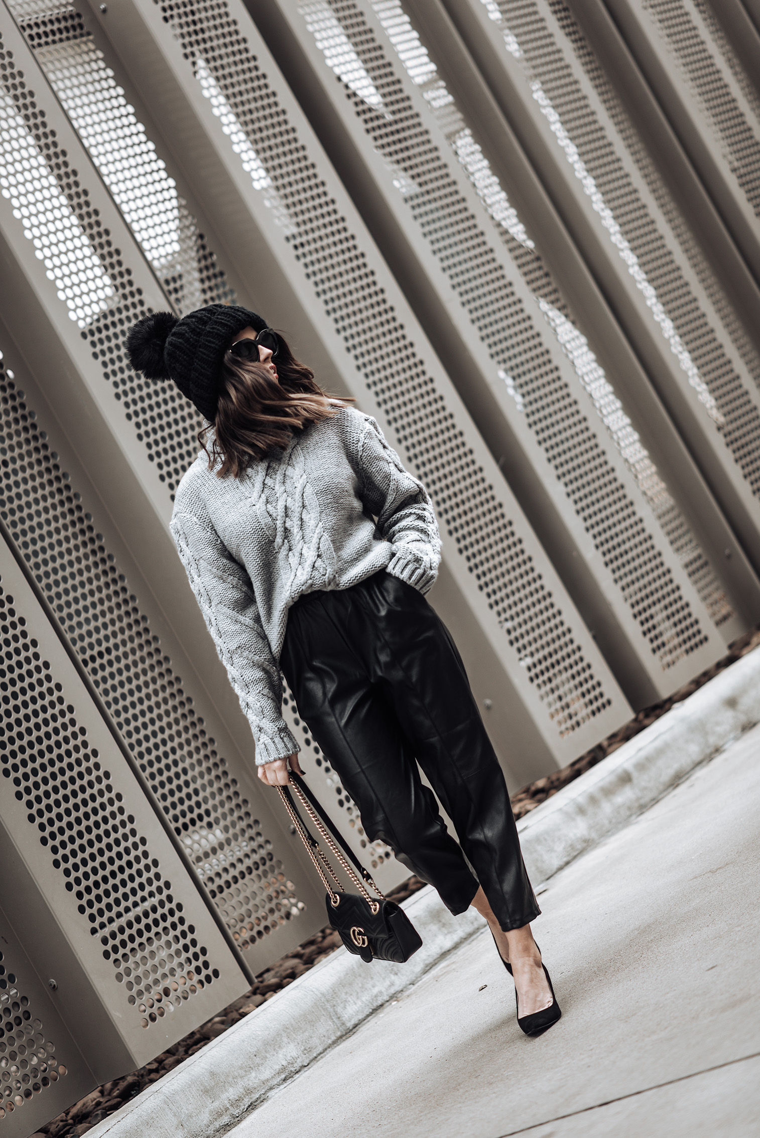 Tiffany Jais fashion and lifestyle blogger of Flaunt and Center   Houston fashion blogger   Leather joggers   Streetstyle blog   Grey chunky knit sweater (similar)   Leather pant   Mini GG Marmot bag   Oversized chunky knit beanie (sold out similar here) #streetstyle #blog #chunkysweater