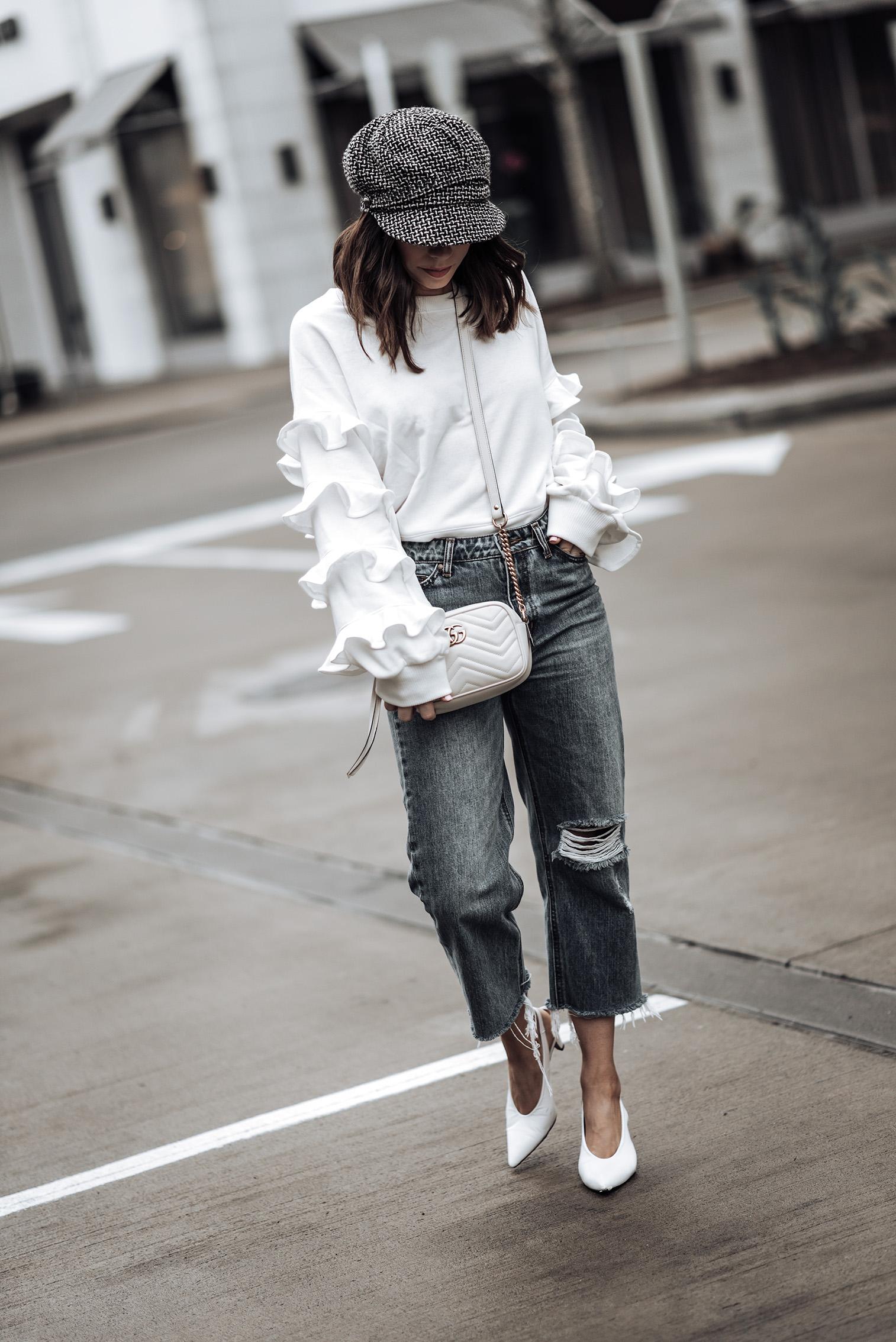 Ruffle details  Ruffle Sleeve Terry Pullover (similar)   Gucci GG Marmont bag   Jeans (similar)   Tweed Baker's Boy Cap   White Slingback Heels #bakerhat #liketkit #slingbackheels #streetstyle