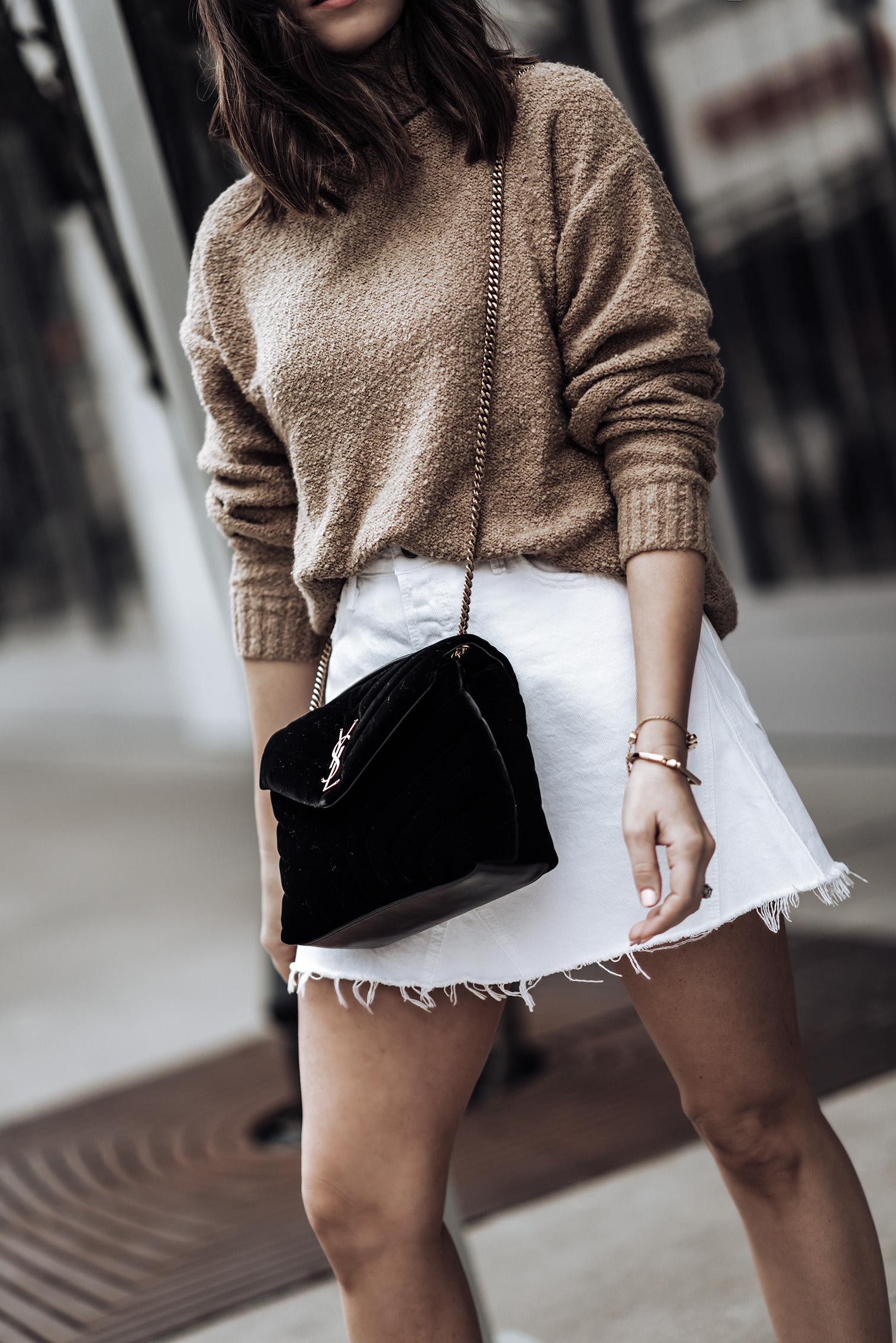 Combat boot trend   #streetstyle #blog #liketkit {C/O}GRLFRND Denim Eva A- Frame Skirt   {C/O} House of Harlow 1960 x REVOLVE Renee Pullover   Saint Laurent Small Black LouLou Velvet Bag   Bakers Cap (Similar)  Balenciaga boots Real vs.Steal)
